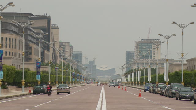 view of a city in putrajaya, malaysia - putrajaya stock videos & royalty-free footage