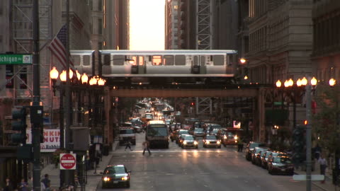 view of a city street in chicago united states - elevated train stock videos & royalty-free footage