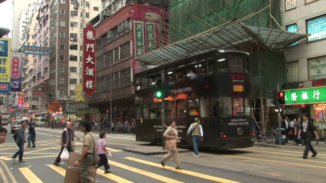 view of a city street in hong kong china - zebramuster stock-videos und b-roll-filmmaterial