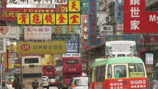 view of a city street in hong kong, china - double decker bus stock videos & royalty-free footage