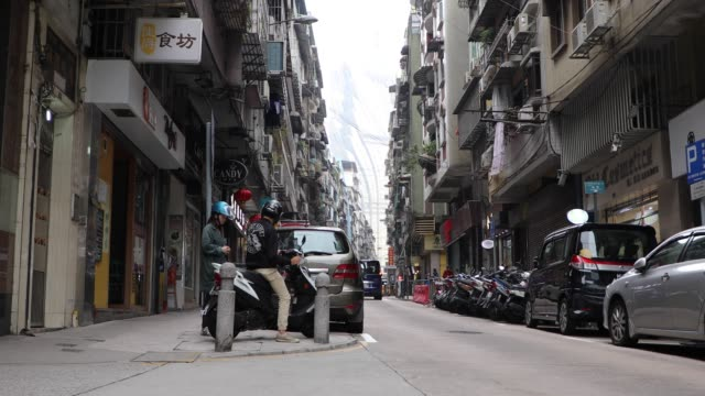 view of a city street in macao,china - macao stock videos & royalty-free footage
