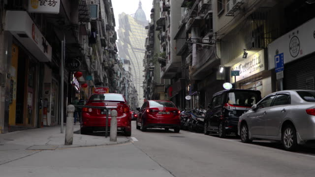view of a city street in macao,china - traditionally portuguese stock videos and b-roll footage