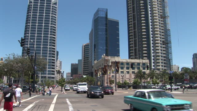 view of a city street in san diego united states - fan palm tree stock videos & royalty-free footage