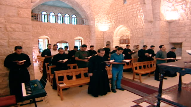 view of a congregation of maronite monks praying at the church of the kfifan monastery. - christianity stock videos & royalty-free footage