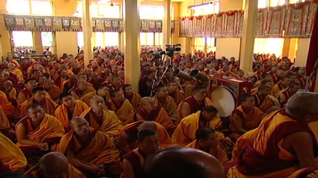view of a congregation of monks praying with the dalai lama at tsuglagkhang temple buddhists flock to the temple to attend his public teachings - meditating stock videos & royalty-free footage