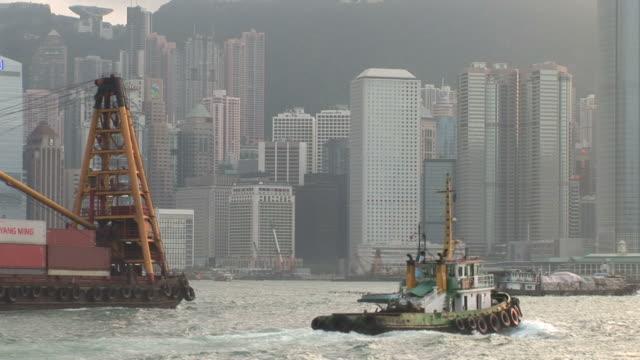 vídeos de stock, filmes e b-roll de view of a container ship cruising in hong kong china - passear sem destino