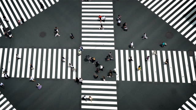 slo mo aerial view of a crossing in ginza / tokyo, japan - ginza stock videos & royalty-free footage