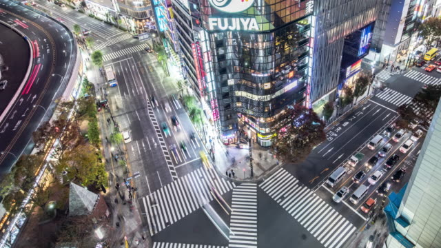 t/l ws ha view of a crossroad in ginza at night / tokyo, japan - 2020 business stock videos and b-roll footage