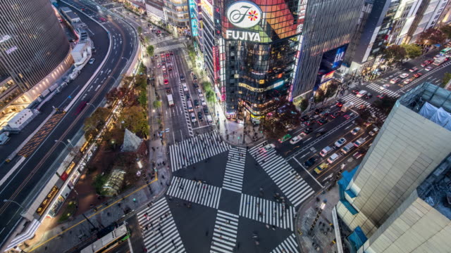 t/l ws ha view of a crossroad in ginza at night / tokyo, japan - giappone video stock e b–roll