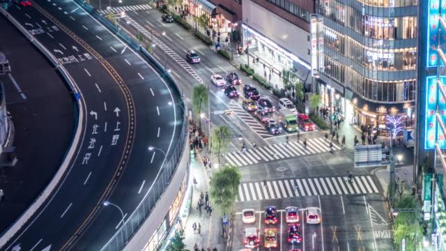 t/l ls ha zo view of a crossroad in ginza at night / tokyo, japan - 高速道路点の映像素材/bロール