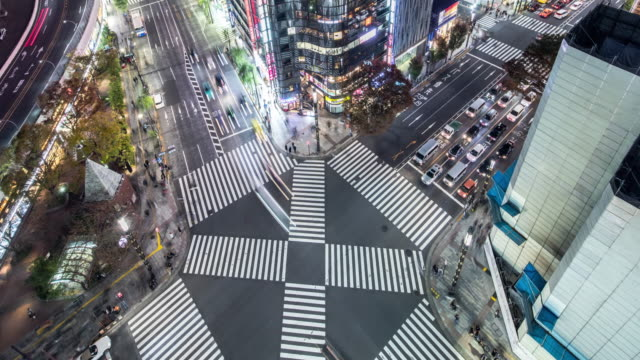t/l ws ha zo view of a crossroad in ginza at night / tokyo, japan - road junction stock-videos und b-roll-filmmaterial