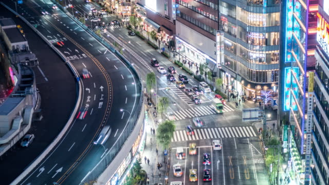 t/l ls ha view of a crossroad in ginza at night / tokyo, japan - ginza stock videos & royalty-free footage
