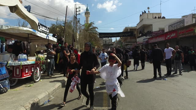 view of a crowd of shia devotees at the ashura commemorations organised by hezbollah in nabatieh. ashura is the 10th day of muharram commemorating... - ashura muharram stock videos & royalty-free footage