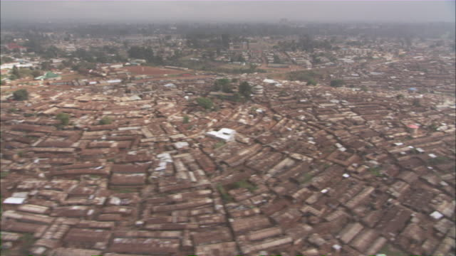ws aerial view of a crowded city showing vast slums / kenya - slum stock videos & royalty-free footage