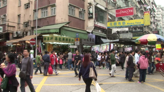view of a crowded city street in hong kong china - pavement video stock e b–roll