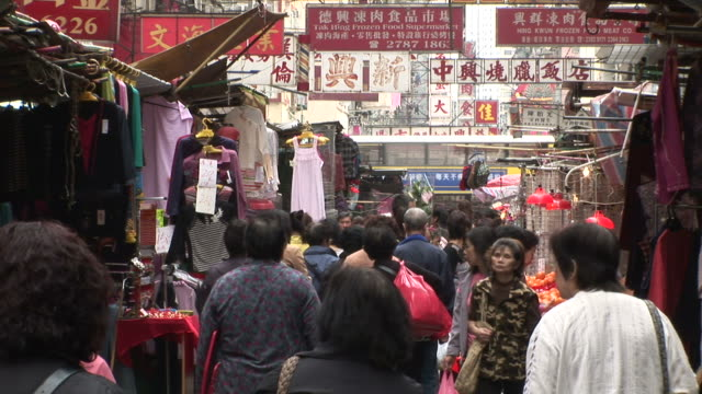 view of a crowded city street in hong kong china - besichtigung stock-videos und b-roll-filmmaterial