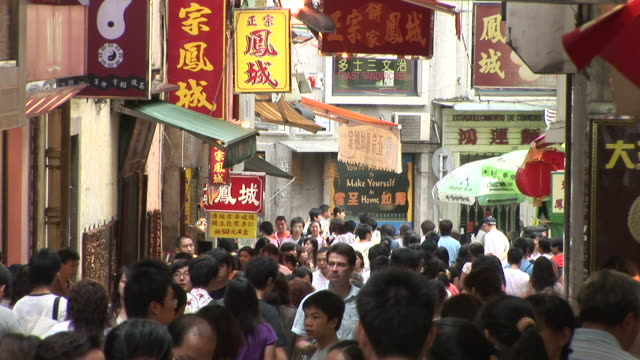 view of a crowded walkway in macau china - macao stock videos & royalty-free footage