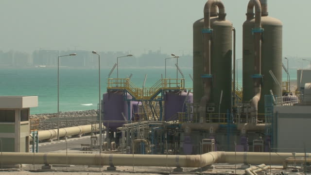 view of a desalination plant the uae is the world's second largest desalination producer one plant alone can make half a billion gallons of fresh... - cube stock videos & royalty-free footage