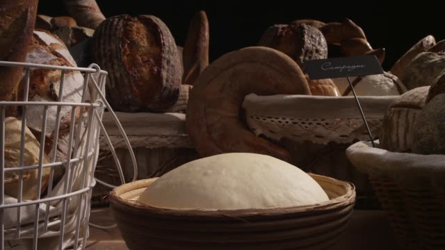 view of a dough becoming fermented by the yeast - dough stock videos & royalty-free footage