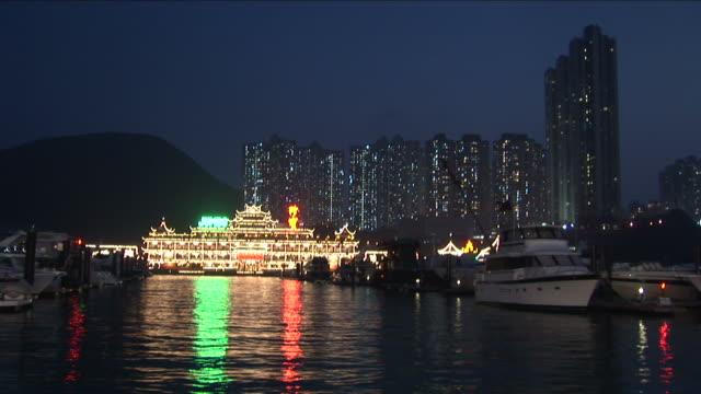 View of a floating restaurant at night in Hong Kong China
