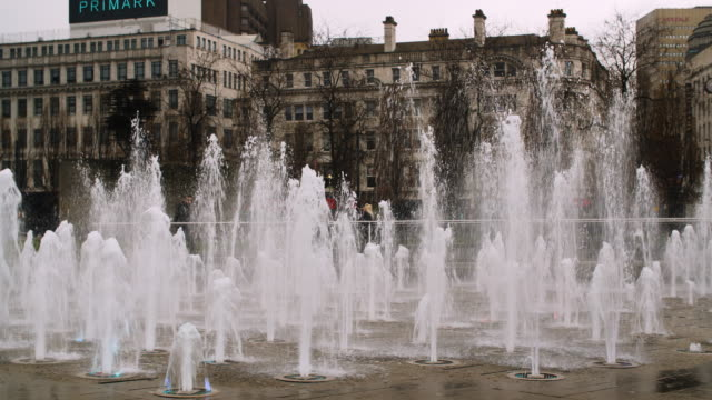 view of a fountain in piccadilly gardens, manchester - manchester england stock videos & royalty-free footage