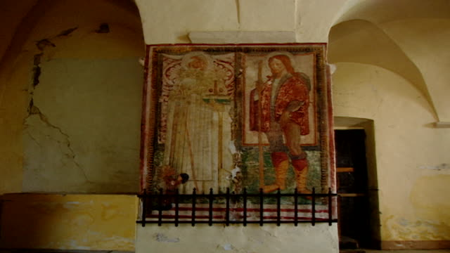 view of a fresco of saint maron and saint rocco at the church of saint maron in volperino. during the crusades the relics of saint maron, founder of... - the crusades stock videos & royalty-free footage