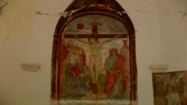 view of a fresco of the crucifixion at the church of saint maron in volperino. during the crusades the relics of saint maron, founder of the maronite... - the crusades stock videos & royalty-free footage