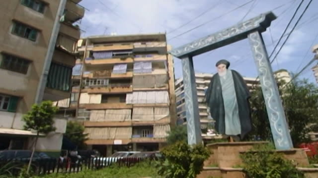 view of a garden in a residential area in dahieh district a framed cutout of grand ayatollah ruhollah khomeini the late 1st supreme leader of iran... - shi'ite islam stock videos & royalty-free footage