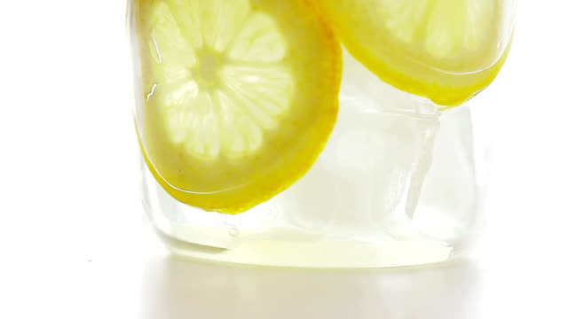 view of a glass cup filling with lemon juice - fizzy lemonade stock videos & royalty-free footage