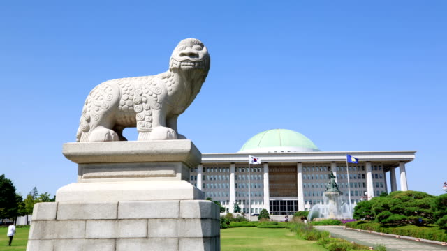 View of a Haetae (Mythical Unicorn-Lion) stone statue and National Assembly Building in Yeouido