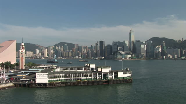 view of a harbor in hong kong china - turmuhr stock-videos und b-roll-filmmaterial