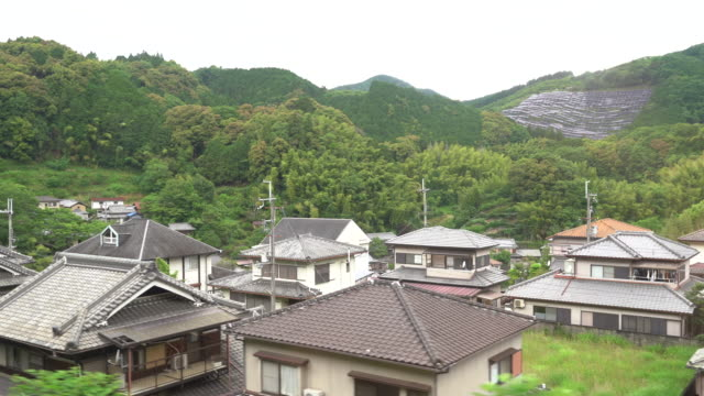 view of a japanese village from the train - village点の映像素材/bロール
