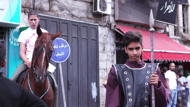 view of a kid holding a spear and one sitting on a horse waiting to renact the battle of kerbala during the ashura commerations in nabatieh ashura is... - ashura muharram stock videos & royalty-free footage