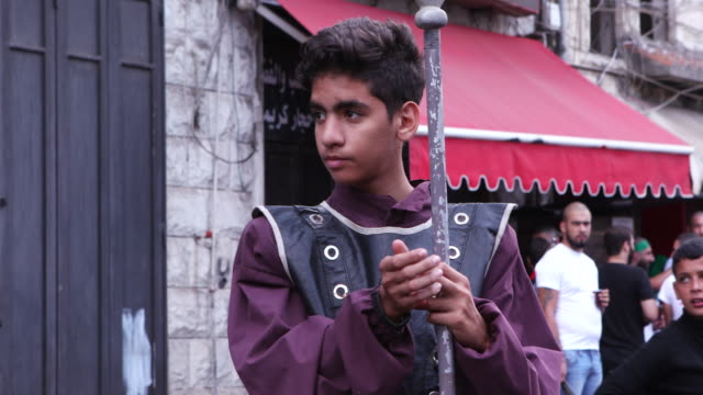 view of a kid holding a spear waiting to renact the battle of kerbala during the ashura commerations in nabatieh ashura is the 10th day of muharram... - ashura muharram stock videos & royalty-free footage