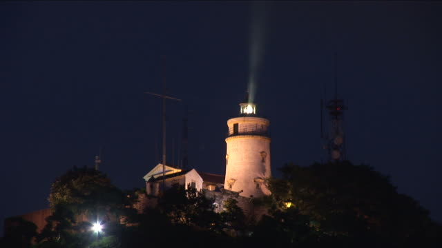 view of a lighthouse in macau china - lighthouse stock videos & royalty-free footage