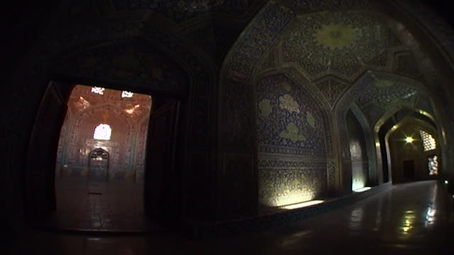 view of a lit passageway showing the haft rangi style of tile mosaic used in the safavid era shah mosque predominantly blue and yellowygreen - shi'ite islam stock videos & royalty-free footage