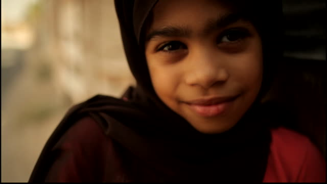 view of a little bahraini girl smiling for the camera. - only girls stock videos & royalty-free footage