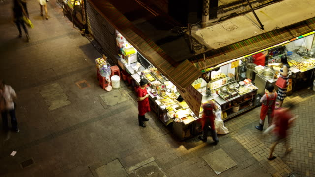 view of a little restaurant in hong kong island at night - hong kong island stock videos & royalty-free footage