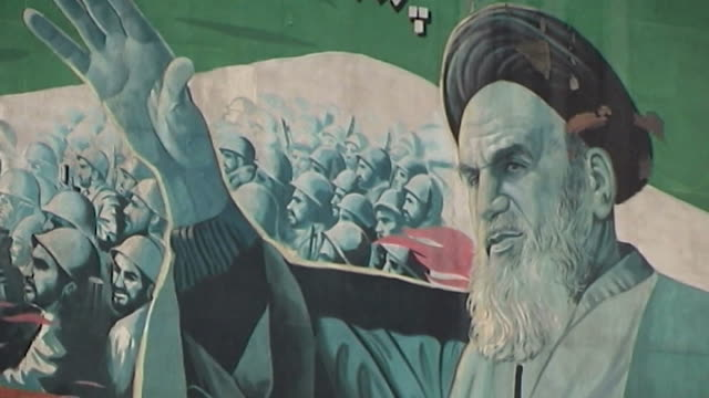 view of a major road and a picture of grand ayatollah ali khamenei, the supreme leader of the islamic republic of iran on a revolutionary poster in... - iran stock videos & royalty-free footage