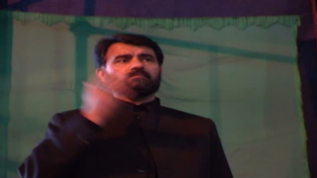 view of a man thumping his chest during ashura in a mosque in isfahan province ashura the tenth day of the islamic month of muharram commemorates the... - government building stock videos & royalty-free footage