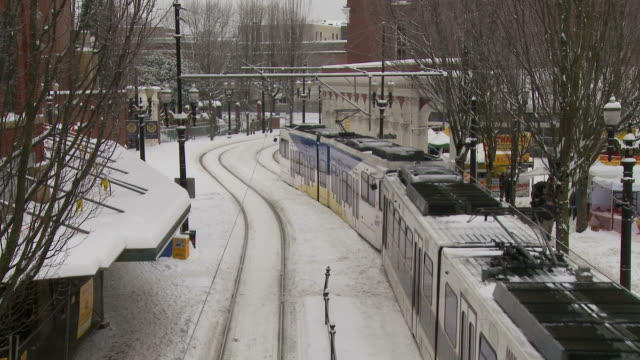 view of a max light rail in portland usa - portland oregon snow stock videos & royalty-free footage