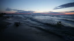A view of a Michigan beach at sunset on a windy day