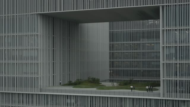 view of a modern office building(amore pacific corporation) and office worker in seoul, south korea - skyscraper stock videos & royalty-free footage