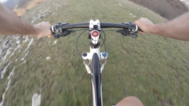 pov view of a mountain bike rider looking at the landscape and the starting to ride his bycicle - human limb stock videos & royalty-free footage