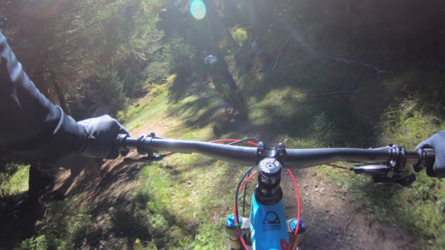 pov view of a mountain biker hands handlebars biking on a singletrack trail. - wearable camera stock videos & royalty-free footage