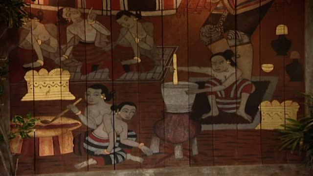 mcu view of a painted wooden panel hanging on a veranda depicting traditional thai women cooking - veranda stock videos & royalty-free footage