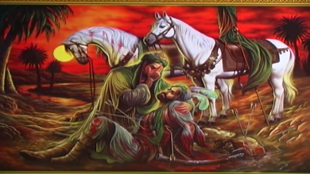 view of a painting depicting the death of hussain ibn ali at the battle of kerbala. this type of painting is used in the ashura commemorations. - ashura muharram stock videos & royalty-free footage