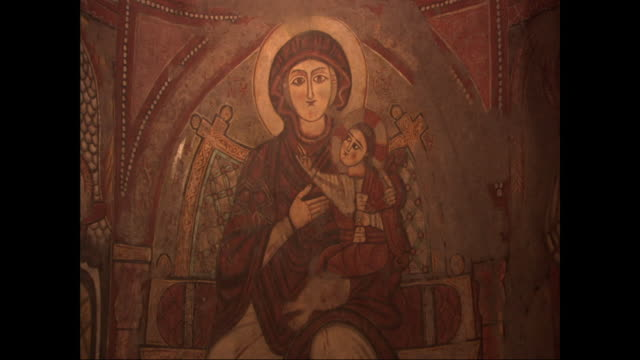 stockvideo's en b-roll-footage met a view of a painting of mary holding the baby jesus shifts to a view of a painting of jesus. - jezus christus