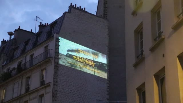 view of a public film screening projected on a wall by the movie theater la clefon april 24 2020 in paris france the coronavirus pandemic has spread... - treble clef stock videos & royalty-free footage