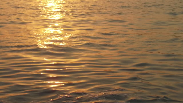 view of a ray of sun sparkling in the sea at sunset. - rippled stock videos & royalty-free footage
